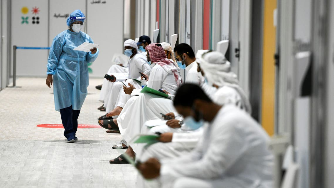 People sit as they wait their turn for vaccine trials at Abu Dhabi National Exhibition Centre in Abu Dhabi, United Arab Emirates, October 6, 2020. Picture taken October 6, 2020. (Reuters)