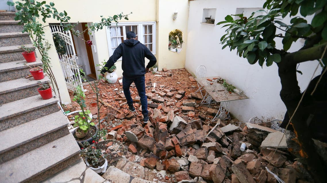 A man walks over debris after an earthquake, in Zagreb, Croatia December 29, 2020. (Reuters)