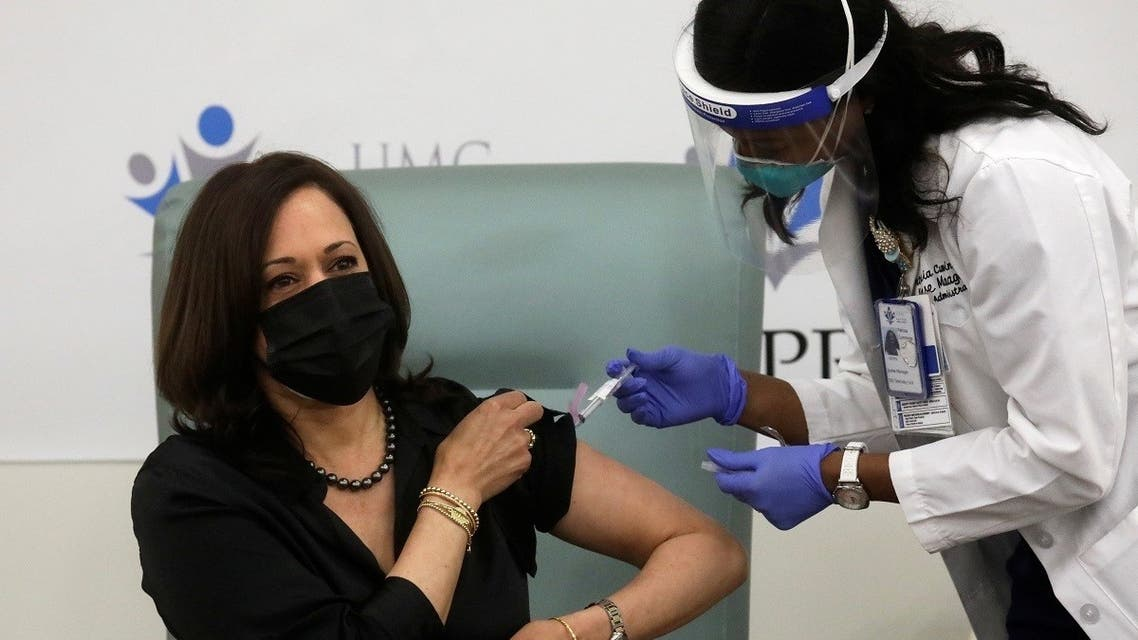 Registered Nurse Patricia Cummings gives US Vice President-elect Kamala Harris a dose of the Moderna COVID-19 vaccine at United Medical Center in Washington, US, December 29, 2020. (Reuters/Leah Millis)