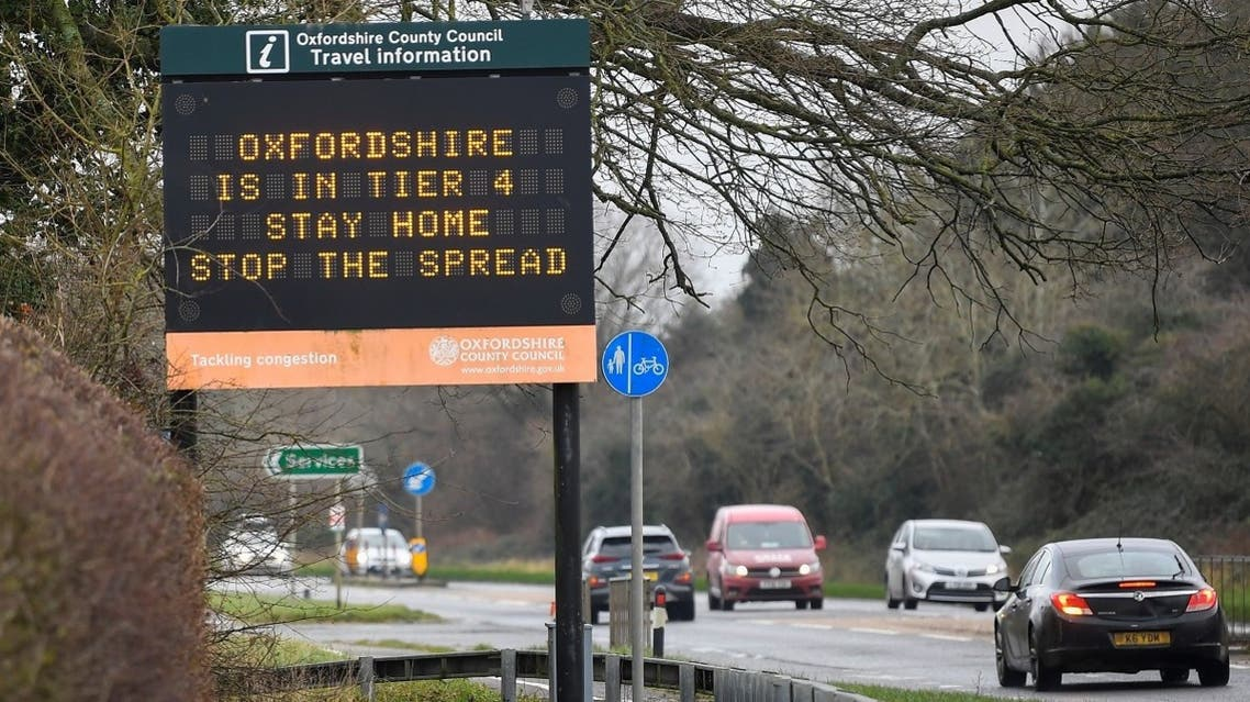 Vehicles drive past a roadside public health information sign, amidst the spread of the coronavirus pandemic, near Oxford, Britain, on December 28, 2020. (Reuters)