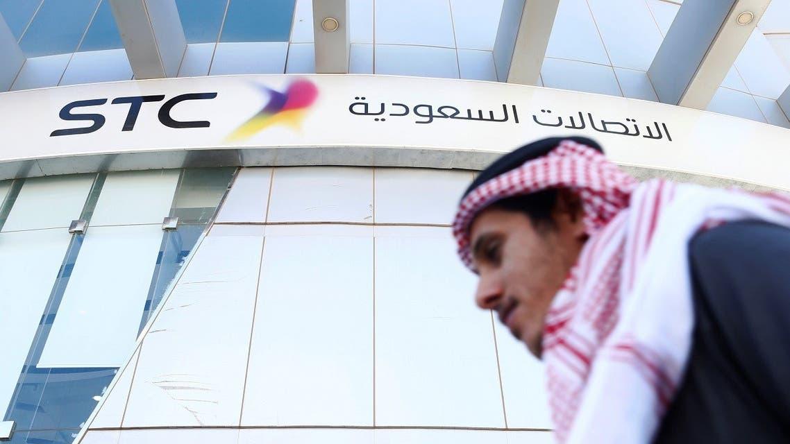 A man passes the Saudi Telecom STC office in Riyadh. (Reuters)