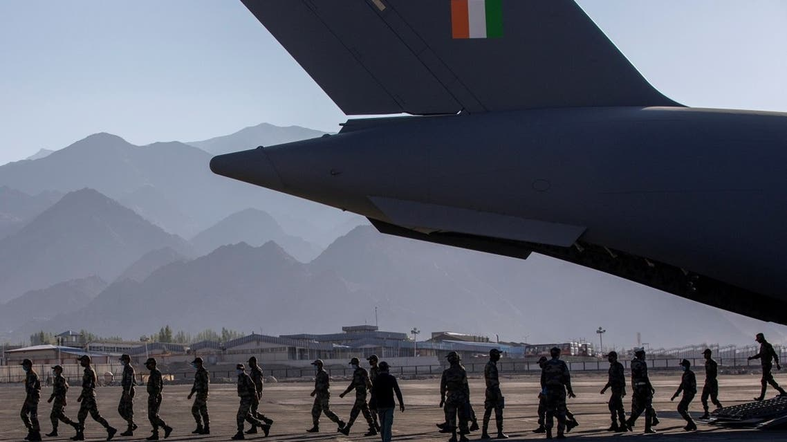 Indian soldiers disembark from a military transport plane at a forward airbase in Leh, in the Ladakh region, on Septem