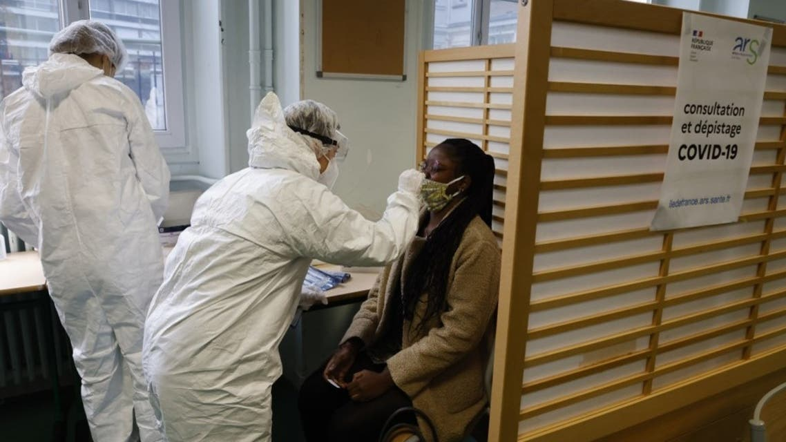 A student of the Emile Dubois Lycee takes part in antigen testing for the novel coronavirus, Covid-19, in Paris on November 23, 2020. (AFP)