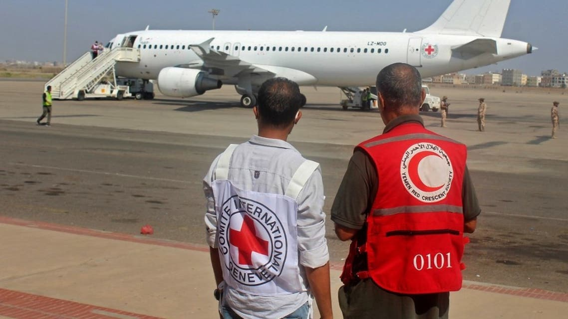 International Committee of the Red Cross (ICRC) and a Red Crescent volunteer look at an Airbus A320 aircraft at an airport in Yemen's southern city of Aden, the interim seat of the Yemeni government, on October 16, 2020. (AFP)