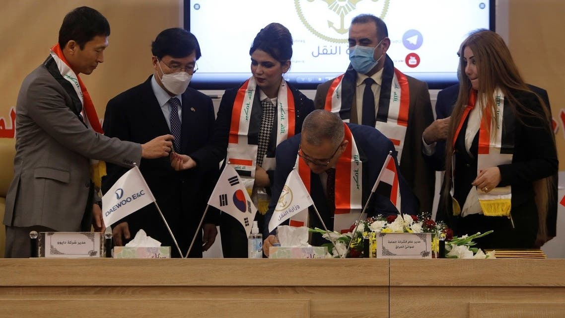 Iraq's director general at the General Company for Ports, Farhan al-Fartousi, signs a contract with South Korea?s Daewoo Engineering & Construction, to construct the Grand Faw port, Baghdad, Iraq, December 30, 2020. (Reuters/Khalid al-Mousily)