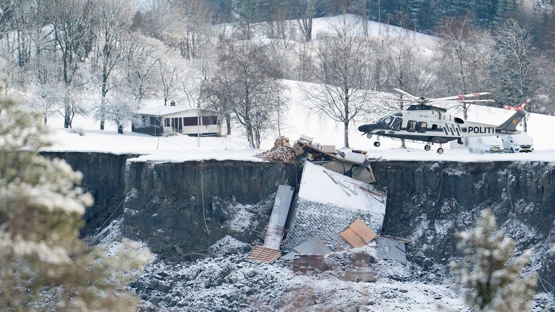 Police helicopter works after yesterday's landslide in Ask, Gjerdrum municipality, Norway, on December 31, 2020. (Reuters)