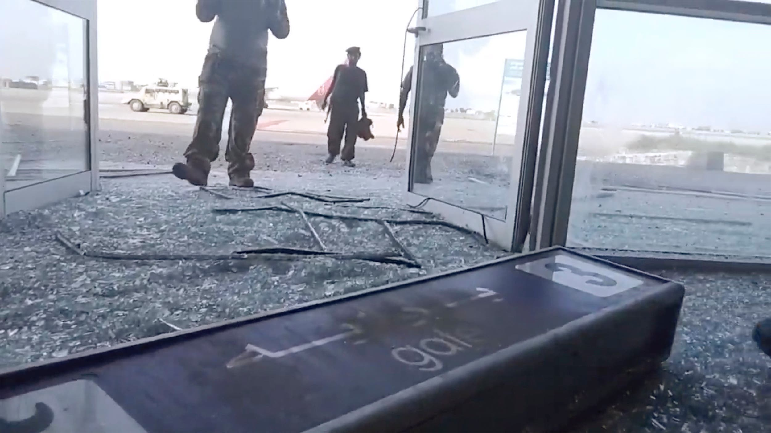 Glass and debris covers the damaged portion of the airport in Yemen's southern city of Aden after an explosion. (File photo: AP)