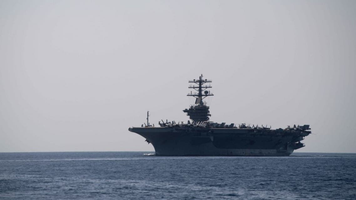 In this image released by the US Navy, the aircraft carrier USS Nimitz transits the Strait of Hormuz on September 18, 2020. (AFP)