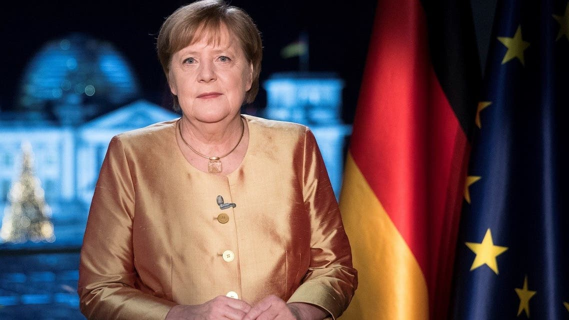German Chancellor Angela Merkel poses for photographs after the television recording of her annual New Year's speech at the chancellery in Berlin, Germany, on December 30, 2020. (Reuters)