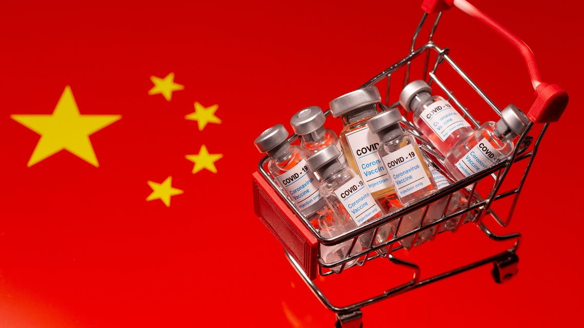 A small shopping basket filled with vials labeled COVID-19 - Coronavirus Vaccine is placed on a Chinese flag in this illustration taken November 29, 2020. (Reuters)