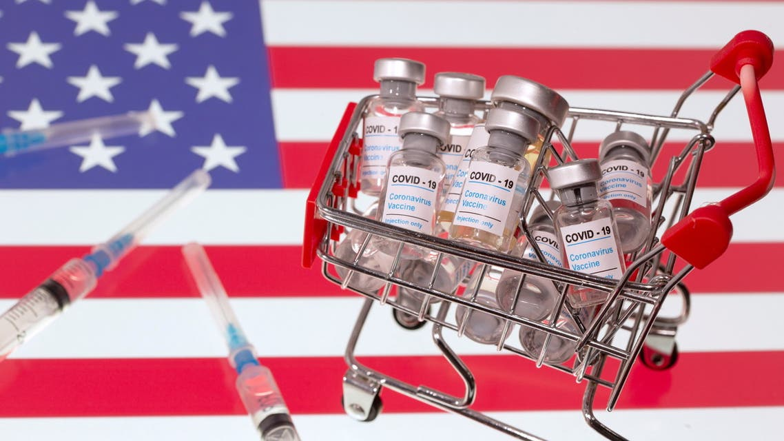 A small shopping basket filled with vials labeled COVID-19 - Coronavirus Vaccine and medical syringes are placed on a U.S. flag in this illustration taken November 29, 2020. (Reuters)