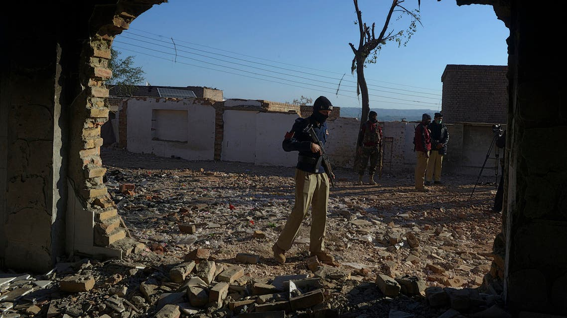 A policeman stands guard at the burnt Hindu temple a day after a mob attack in a remote village in Karak district, some 160 kms southeast of Peshawar on December 31, 2020. Hundreds of Muslims attacked and set fire to a Hindu temple in northwest Pakistan on December 30, police and witnesses said. Abdul MAJEED / AFP