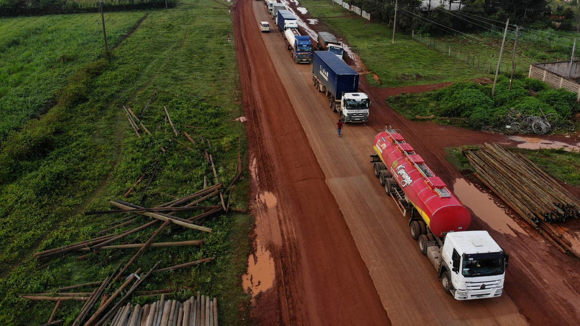 Parked trucks wait in a 10km queue, to cross the Kenyan-Ugandan border from the town of Busia, Kenya November 14, 2020. Picture taken November 14, 2020. (Reuters)
