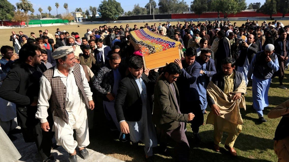 Afghan men carry the coffin of journalist Malalai Maiwand, who was shot and killed by unknown gunmen in Jalalabad, Afghanistan, on December 10, 2020. (Reuters)