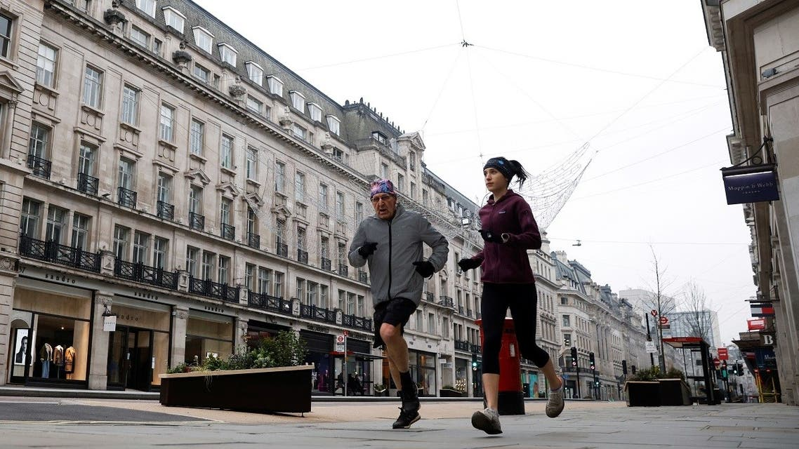 People jog down almost empty Regent Street in New Year's Day amid the coronavirus outbreak, in London, Britain, on January 1, 2021. (Reuters)