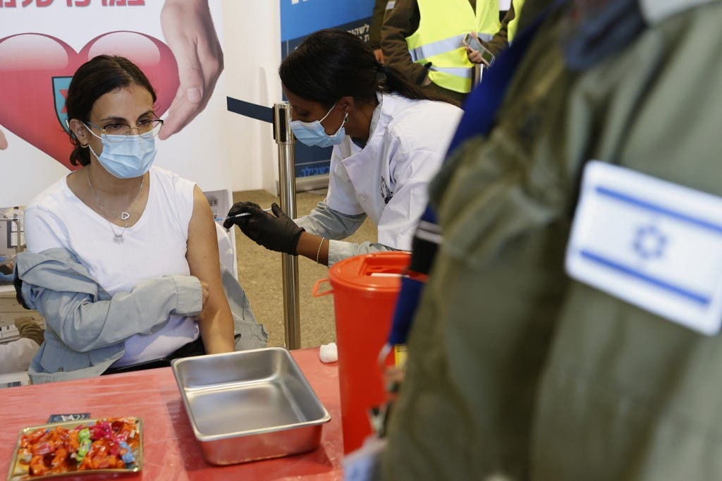 An Israeli military medic gets vaccinated against the coronavirus at the medical centre of Tzrifin military base in the Israeli town of Rishon Lezion. (File photo: AFP)