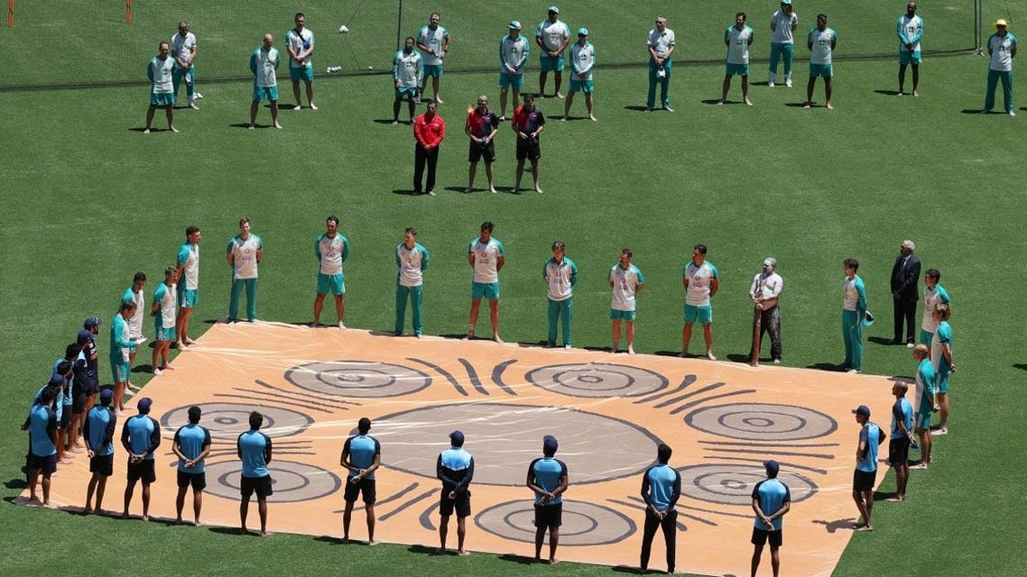The Australian and Indian Teams line up during a ceremony honoring Indigenous Australians before the first One Day International match at the  Sidney Cricket Ground, Sidney, Australia , on November 27, 2020. (Reuters)