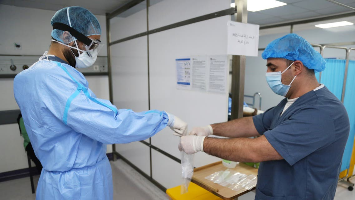A doctor, wearing protective gear, handles a test for the coronavirus disease (COVID-19), at Rafik Hariri University Hospital, in Beirut. (File photo: Reuters)
