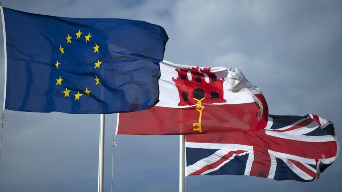 In this file photo taken on January 31, 2020 the EU flag flies next to Gibraltar's flag (C) and the Union Jack (R) in Gibraltar. (AFP)