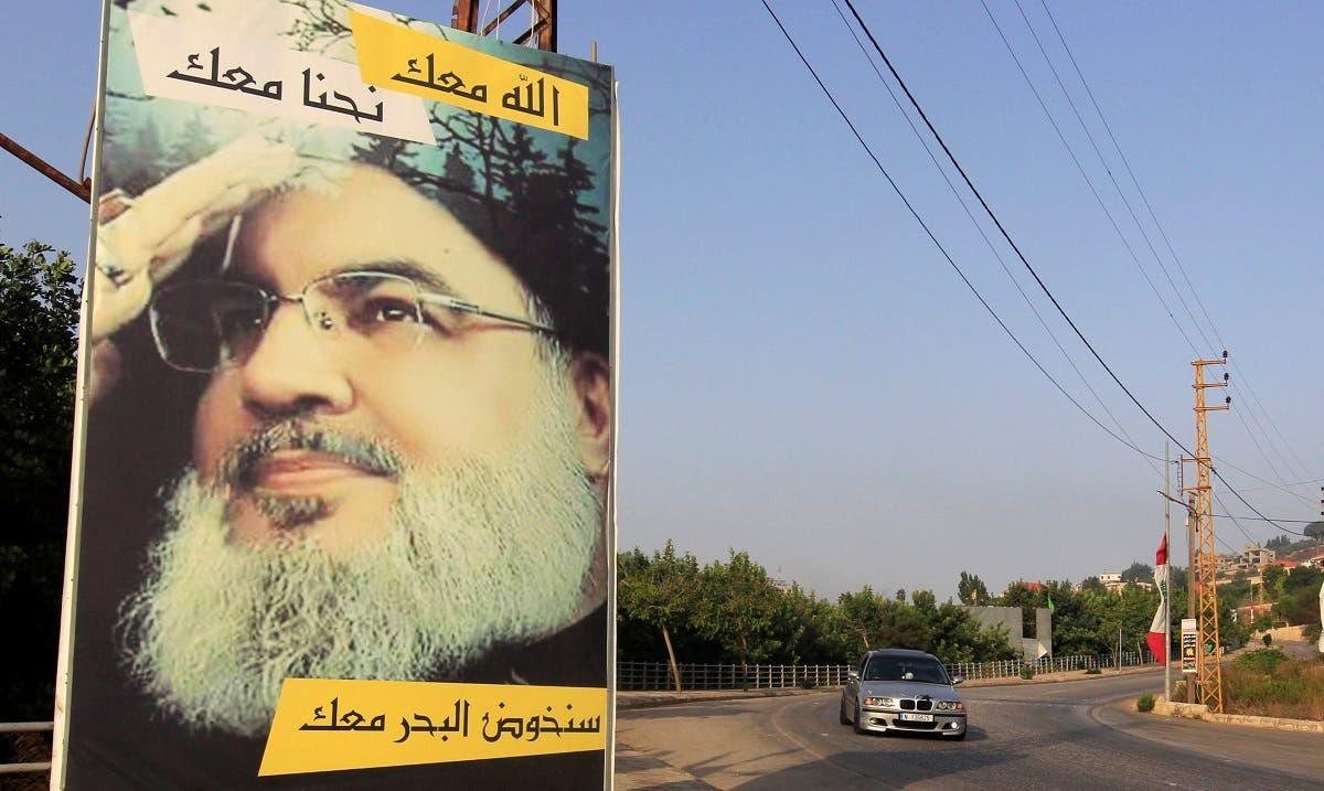 A car drives past a poster depicting Lebanon's Hezbollah leader Sayyed Hassan Nasrallah in Adaisseh village, near the Lebanese-Israeli border, Lebanon. (File photo: Reuters)