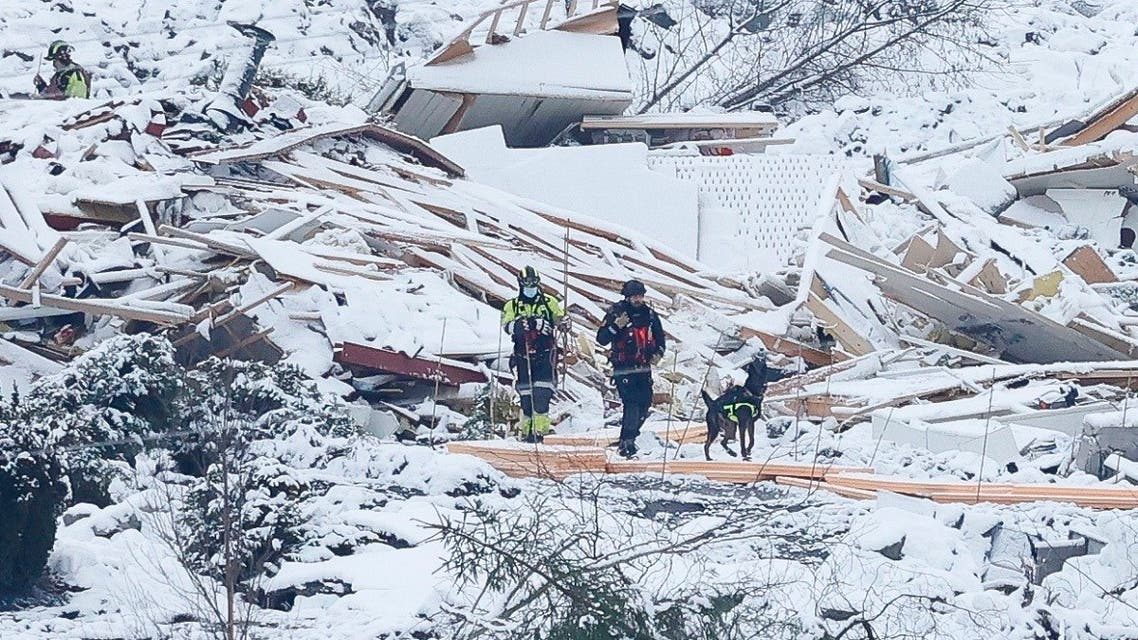 Rescue workers with a dog search the area on January 2, 2021 following the landslide that hit a residential area in Ask in Gjerdrum during Christmas. (Erik Schroeder/NTB/AFP)