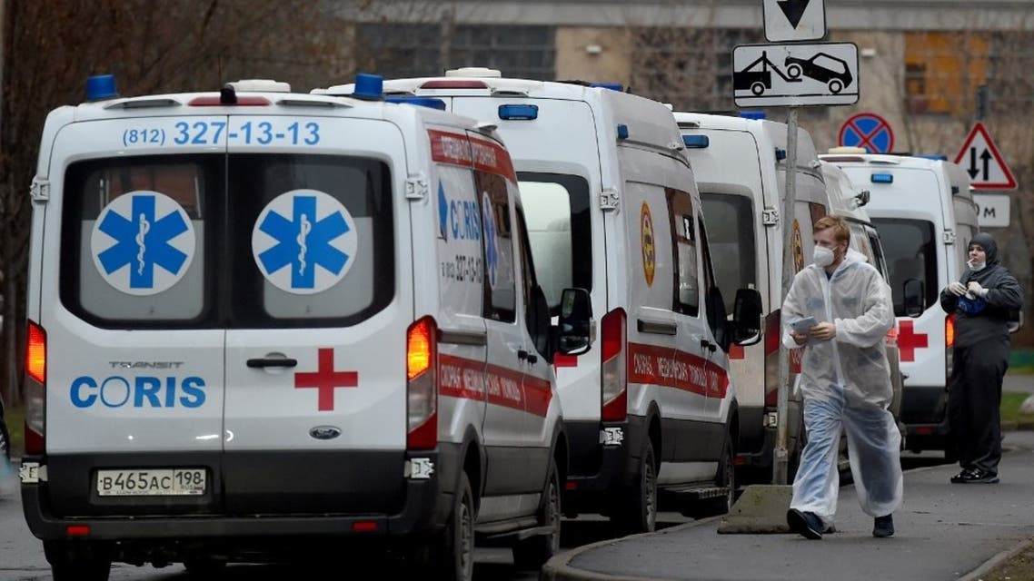 Ambulances queue outside Saint Petersburg's Pokrovskaya hospital, where patients suffering from the coronavirus disease are treated, on December 21, 2020. (AFP)
