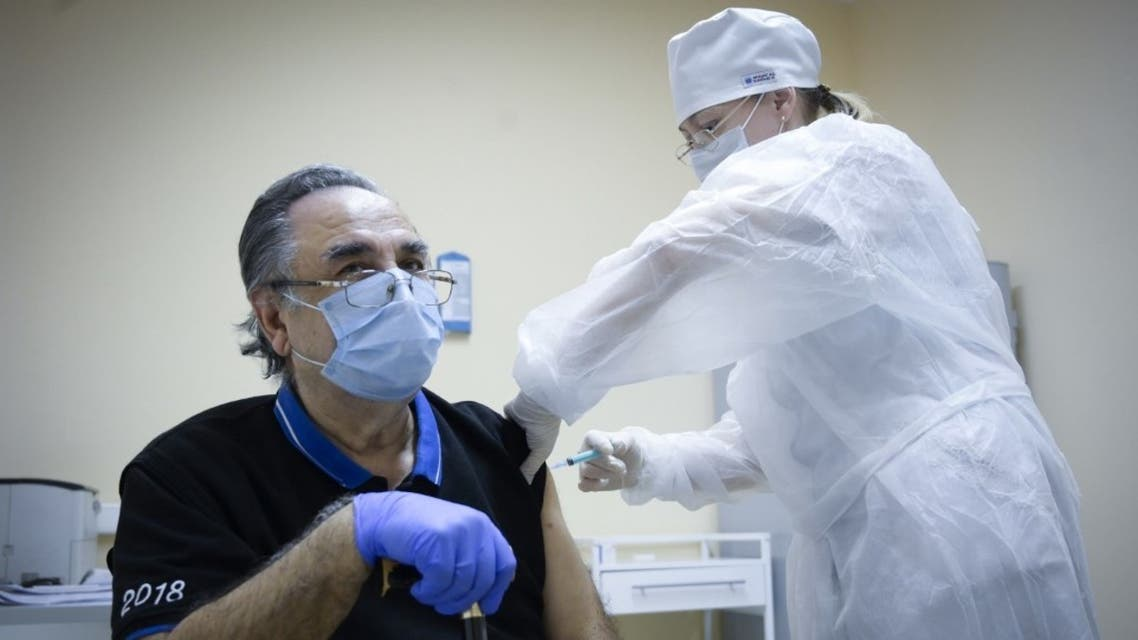 A nurse vaccinates Georgiy Stepanov, 82, with the Sputnik V (Gam-COVID-Vac) Covid-19 vaccine at a clinic in Moscow, on December 30, 2020. (AFP)