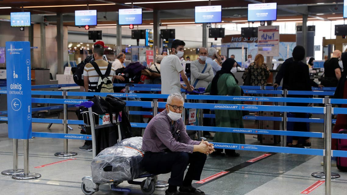 A man sits next to a check-in counter at Sabiha Gokcen Airport in Istanbul. (File photo: Reuters)