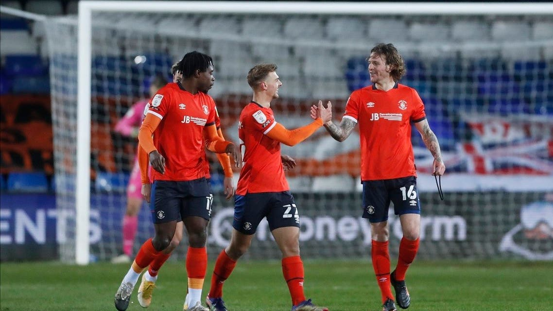 Luton Town's Glen Rea celebrates scoring their first goal with teammates. (Action Images/Matthew Childs)