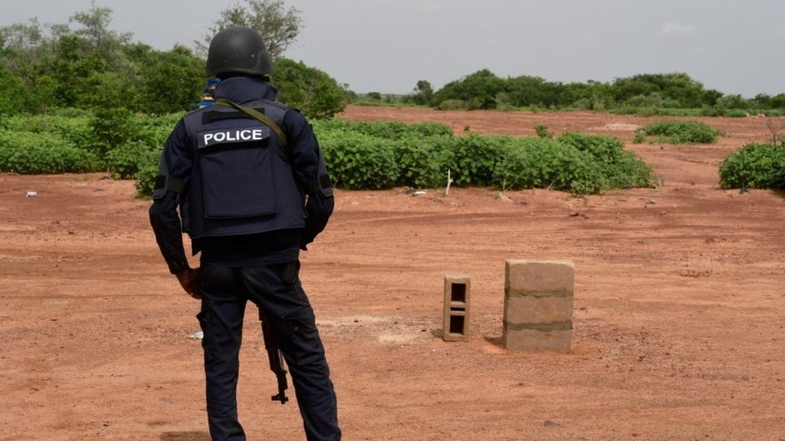 A Nigerien police officer stands guard in the Kouré Reserve, about 60 km from Niamey on August 21, 2020. (AFP)
