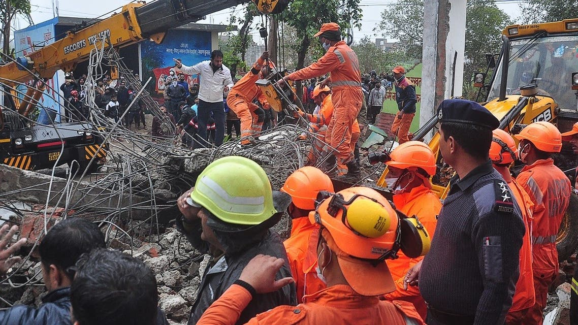 National Disaster Response Force (NDRF) personnel perform a search and rescue operation after a roof of a shelter at a cremation ground collapsed, in Ghaziabad on January 3, 2021. (STR/AFP)