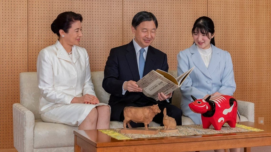 Japan's Emperor Naruhito (C) talking with Empress Masako (L) and their daughter Princess Aiko (R) during a family portrait session for the New Year at their Akasaka Estate residence in Tokyo. (The Imperial Household Agency of Japan/AFP)