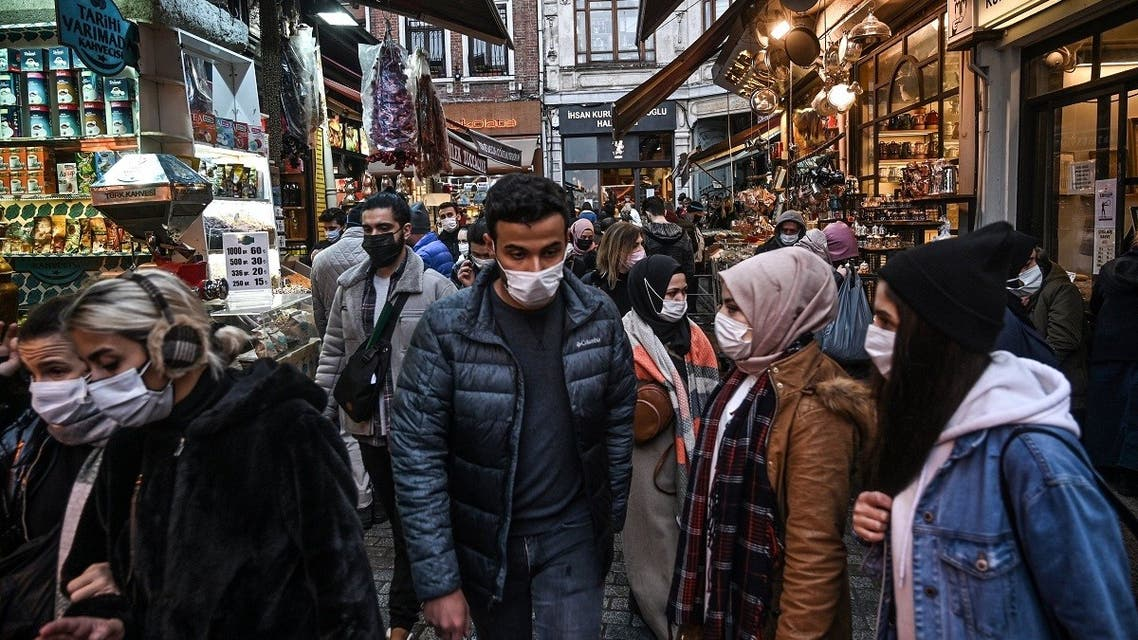 People wear face masks during shopping to prevent the spread of the Covid-19 caused by the novel coronavirus at Eminonu in Istanbul, on December 14, 2020. (Ozan Kose/AFP)