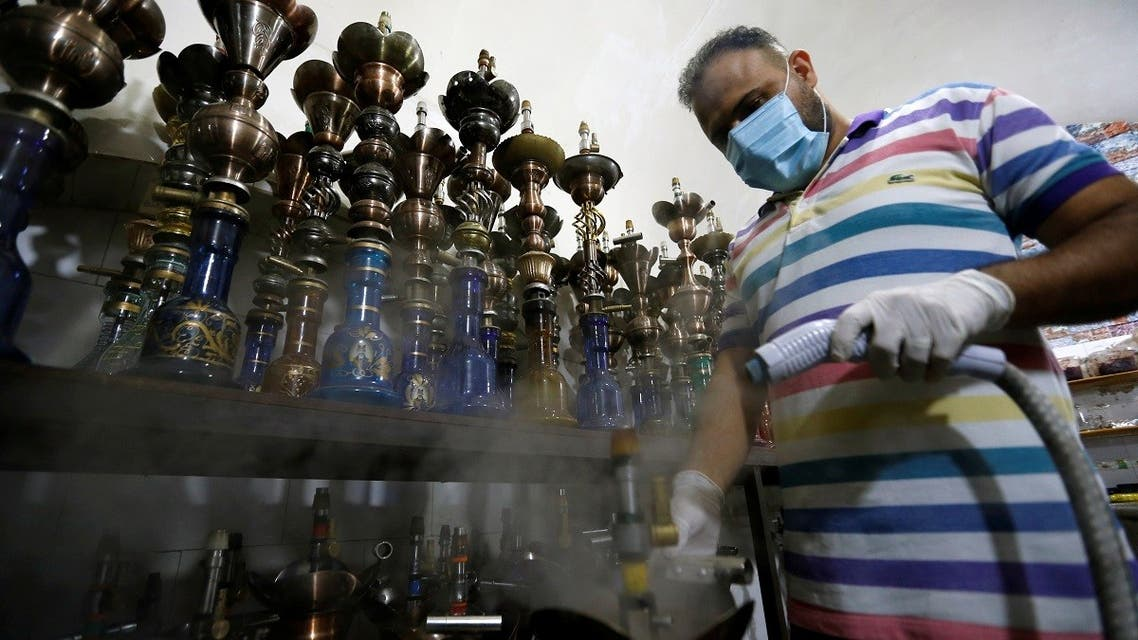 A worker disinfects shisha, amid the outbreak of the coronavirus disease (COVID-19), at al-Faisaliah Cafe in Baghdad, Iraq. (File photo: Reuters)
