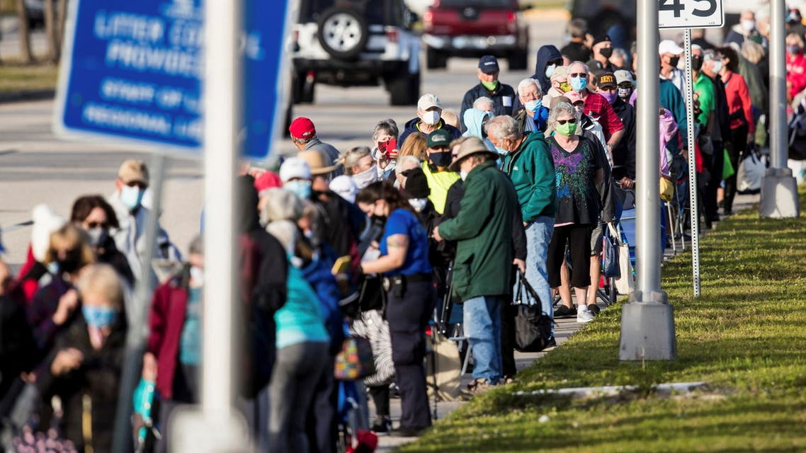 Hundreds wait in line at Lakes Park Regional Library to recieve the COVID-19 vaccine in Fort Myers, Florida, U.S. December 30, 2020.  (Reuters)