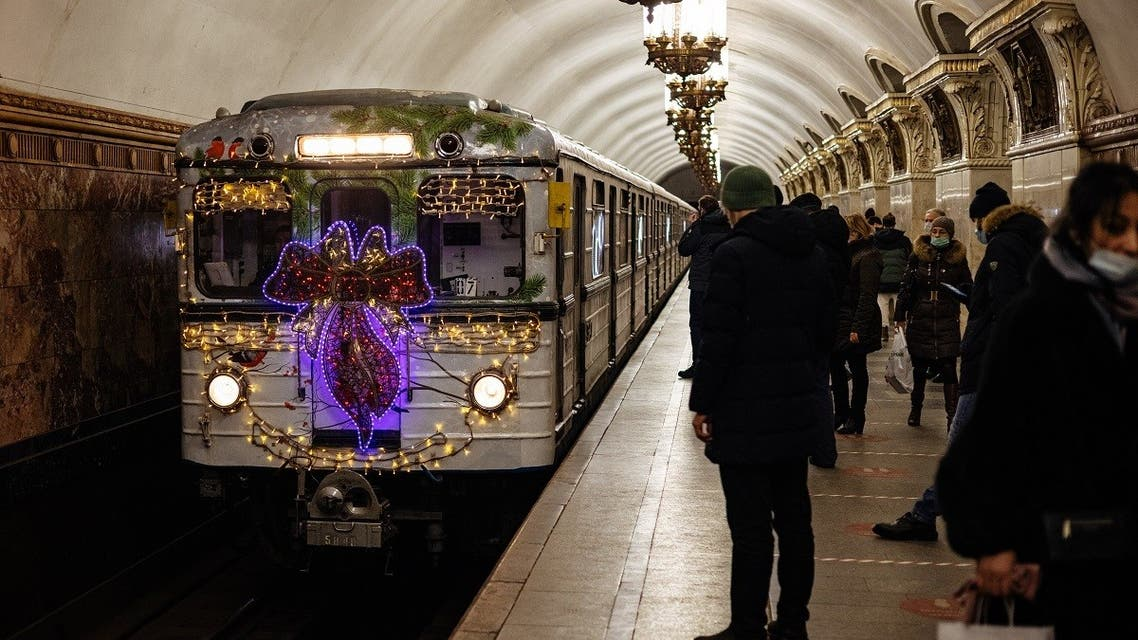 A metro train decorated with Christmas lights arrives at Belorusskaya metro station in Moscow . (AFP)