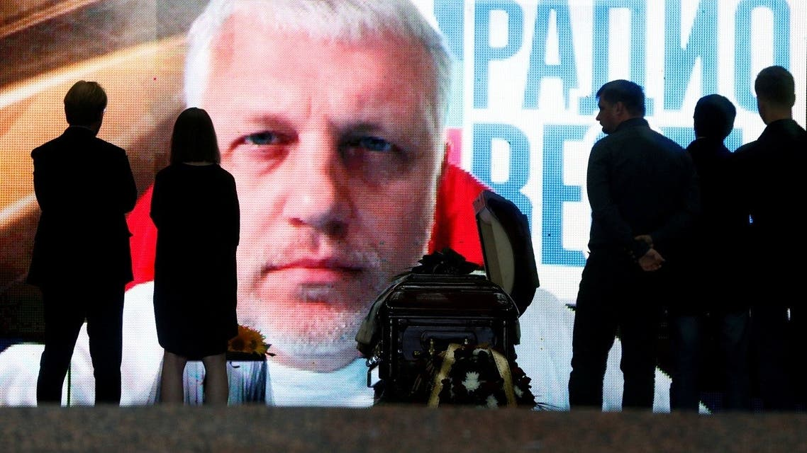 A file photo shows people stand near the coffin containing the body of journalist Pavel Sheremet who was killed by a car bomb, during a memorial service in Kiev, Ukraine, July 22, 2016. (Reuters/Valentyn Ogirenko)