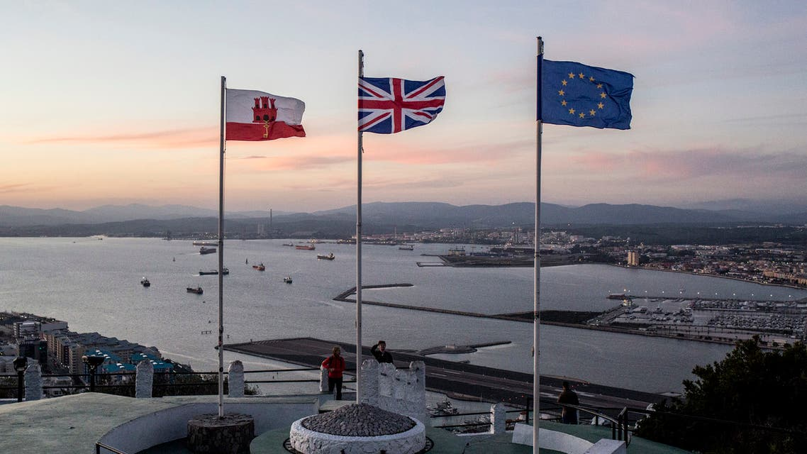 Gibraltar, British and EU flags on the upper rock at the British territory of Gibraltar, Friday Jan. 31, 2020. Britain officially leaves the European Union on Friday after a debilitating political period that has bitterly divided the nation since the 2016 Brexit referendum. (AP Photo/Javier Fergo)