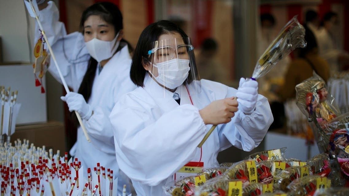 Staff members of a Shinto shrine prepare to sell lucky charms on the first business day of the New Year at the Kanda Myojin shrine amid the coronavirus disease outbreak in Tokyo, Japan, January 4, 2021. (Reuters/Issei Kato)