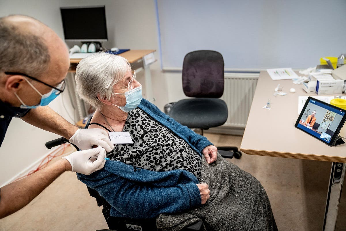 Jytte Margrete Frederiksen, 83, receives the Pfizer-BioNTech coronavirus disease (COVID-19) vaccine, in Ishoj, Denmark December 27, 2020. (Ritzau Scanpix/Mads Claus Rasmussen via Reuters)