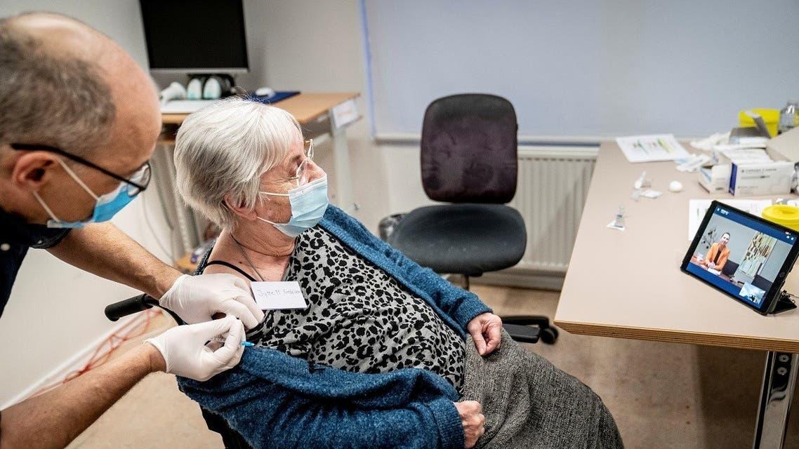 Jytte Margrete Frederiksen, 83, receives the Pfizer-BioNTech coronavirus disease (COVID-19) vaccine, in Ishoj, Denmark December 27, 2020. (Reuters)