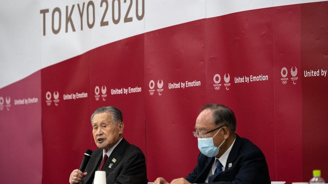 Tokyo 2020 President Yoshiro Mori (L) speaks during the opening remarks session of the Tokyo 2020 Olympics executive board meeting in Tokyo on December 22, 2020. (AP)