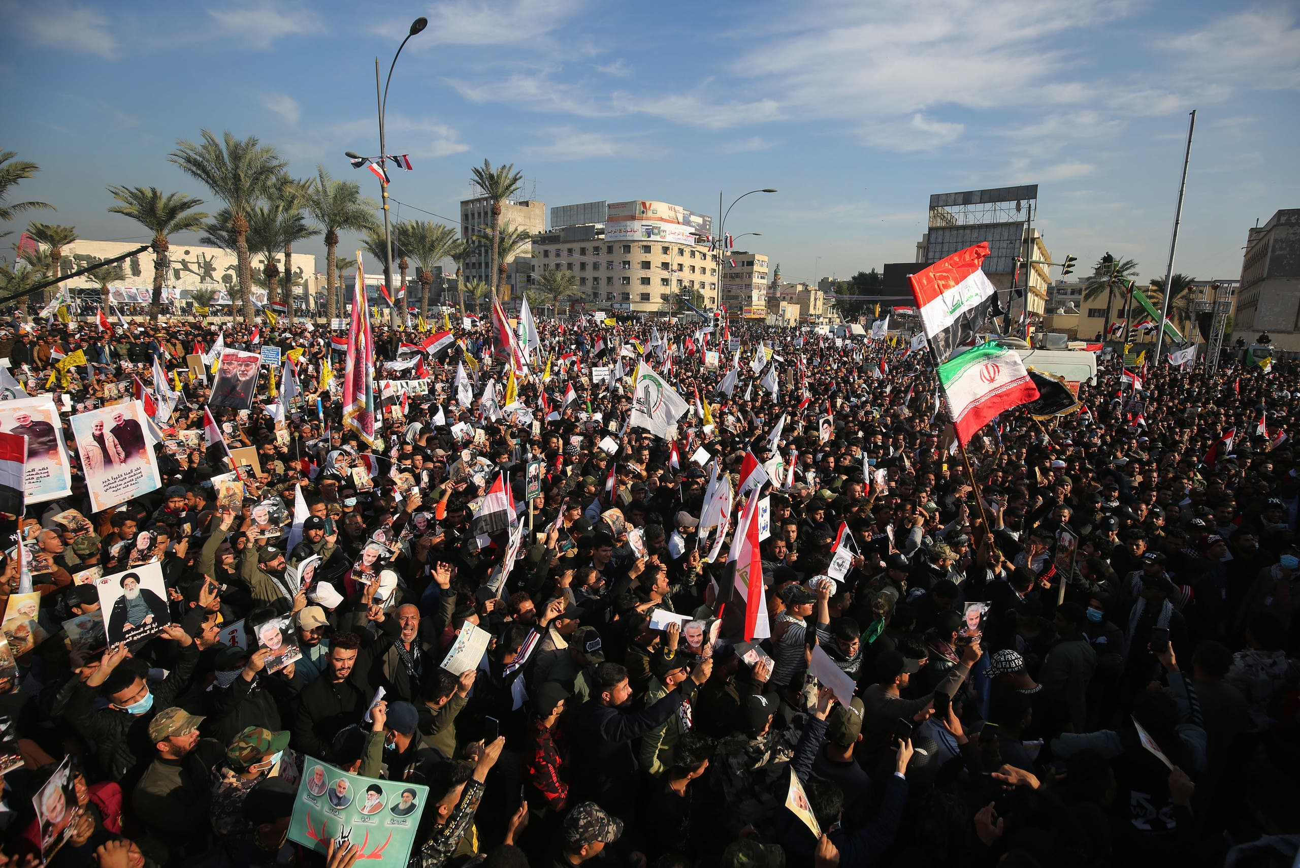Iraqi demonstrators rally in Tahrir square in Baghdad on January 3, 2021, to mark the anniversary of the death of Qasem Soleimani. (AFP)