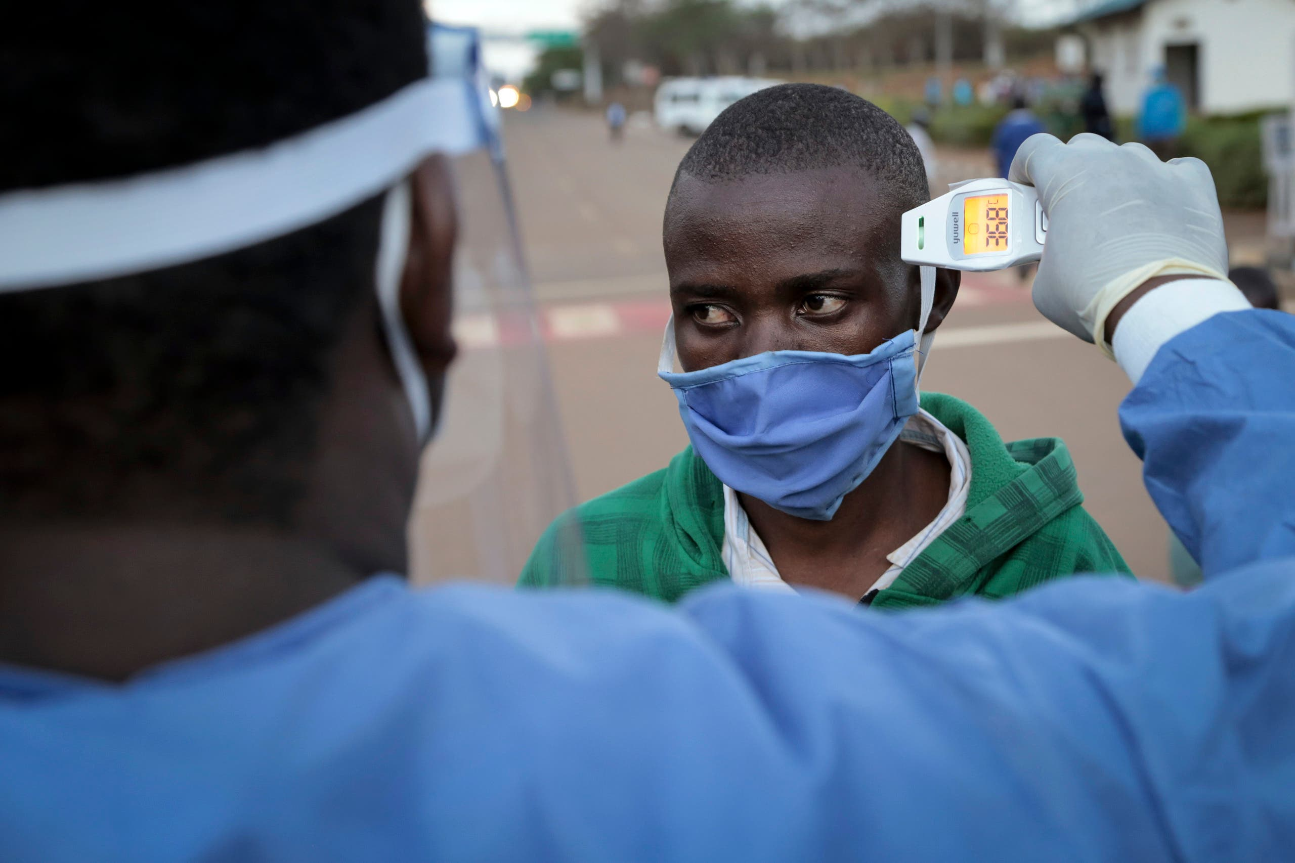 A man  is checked for fever as a precaution against the spread of the coronavirus in Rwanda. (AP)