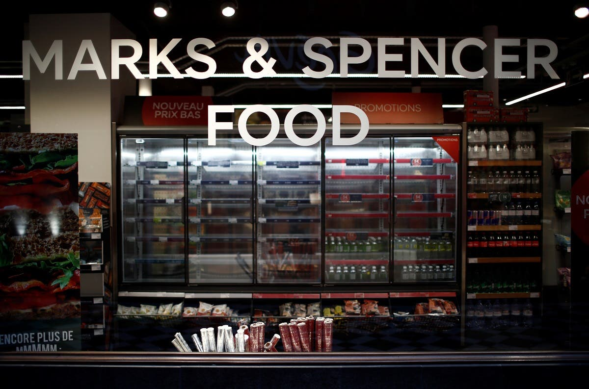 Empty shelves are seen behind a M&S logo at a Marks & Spencer food store in Paris, France, January 5, 2021. (Reuters/Gonzalo Fuentes)