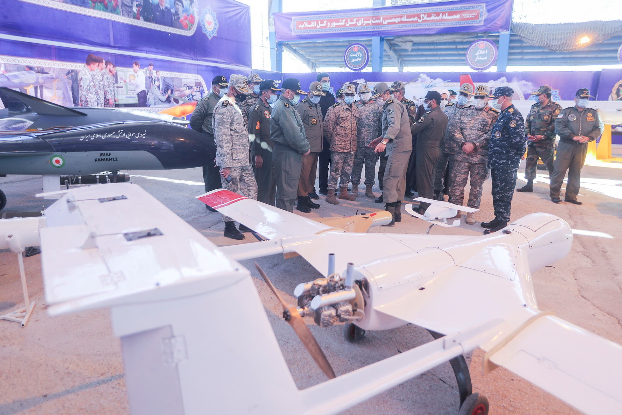 Iranian Armed Forces Chief of Staff Major General Mohammad Bagheri and other top commanders visit Iranian-made military drones, unveiled in an exhibition in Semnan, Iran. (Reuters)