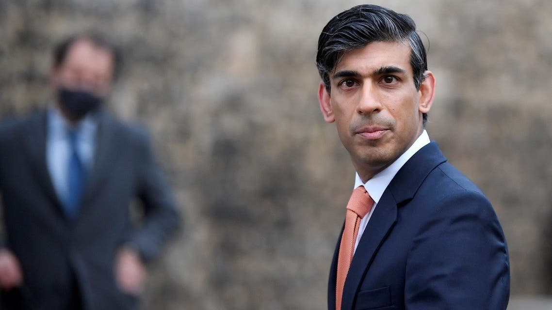 Britain's Chancellor of the Exchequer Rishi Sunak looks on as he leaves following an outside broadcast interview, in London, Britain, on November 26, 2020. (Reuters)