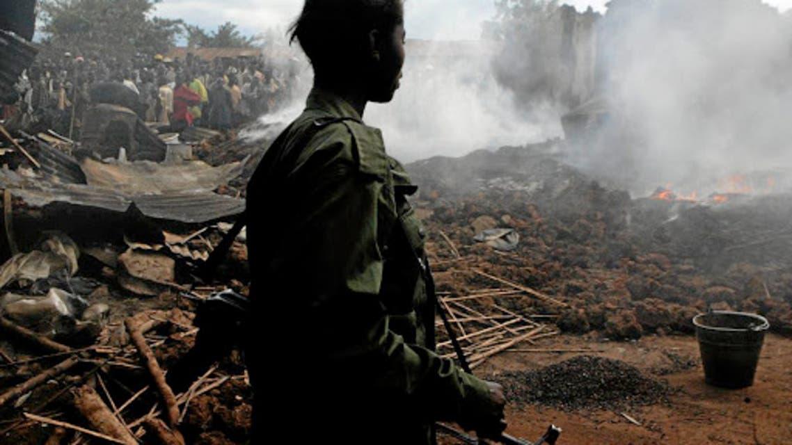a rebel soldier in drc reuters