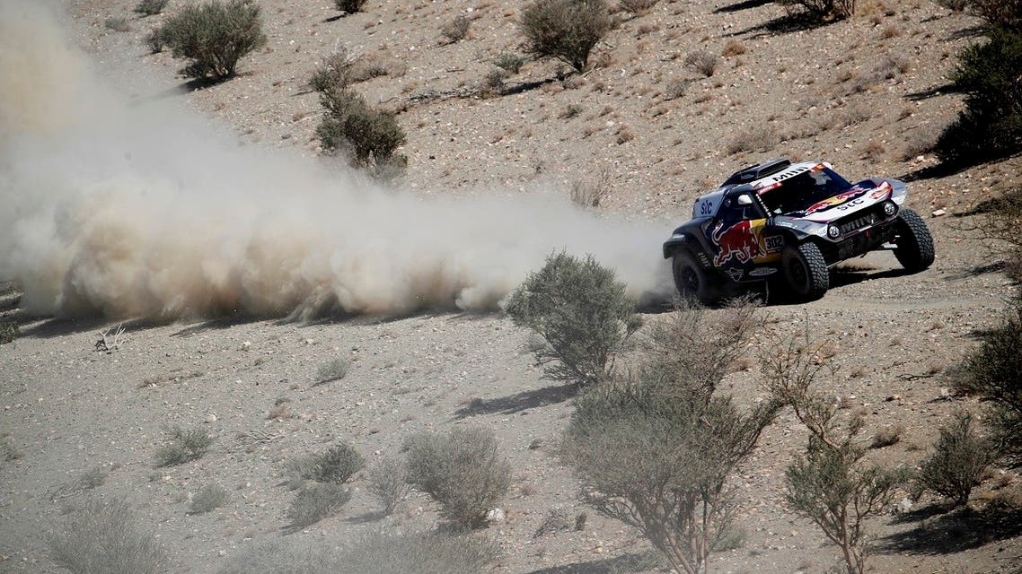 Raid Mini JCW Team's Stephane Peterhansel and Co-Driver Edouard Boulanger in action during stage 1 on January 3, 2021, Saudi Arabia. (Reuters/Hamad I Mohammed)