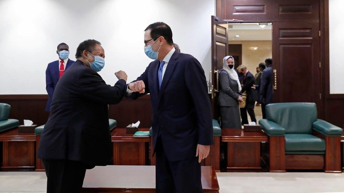 Sudanese Prime Minister Abdullah Hamdok (left), elbow bumps as he welcomes US Treasury Secretary Steven Mnuchin to the Cabinet Building, in Khartoum, Sudan, on January 6, 2021. (AP)26